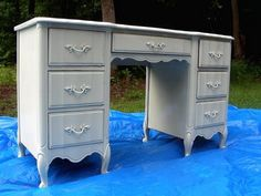 Vintage desk painted white--this looks like my bedroom set, which is badly in need of a makeover