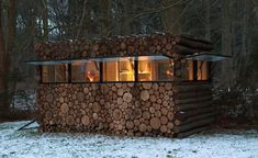 Excellent 'Man Cave' to build in the yard to get away from it all. These are easily made from cord wood, like laying bricks. You can even have the wood cut shot to add insulation in between the cord wood walls.