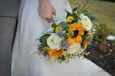 What a beautiful fall mix of sunflowers, roses and thistle with a touch of chamomile. We loved making this fall design. #dallasflorists #roysecityflorists #sunflowerbridalbouquet #fallbridalbouquet #weddingbouquet #fallbouquet #wildflowerbouquet #wildroseevents www.wildroseevents.com