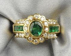 Gold, Emerald, and Diamond Ring, Cartier. I just love Emeralds!