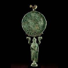 Aboutaams present: Archaic bronze Caryatid Mirror.