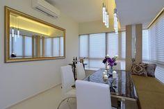 Sala dinign elegante em brilhante apartamento por KNQ Associates