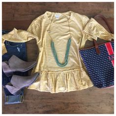 This Peplum tee (comes in many colors) is going to be the tee I grab again and again this fall! And it's ONLY $39!