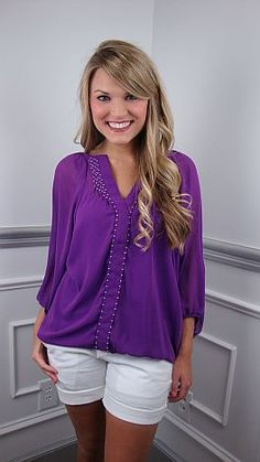 Simple, pretty, and bohemian, this top is perfect in every way. The gorgeous eggplant hue is amazing on every skin tone, and the billowy fit hides all sins! For an easy, casual look, toss it on with shorts and sandals. You're all set!     The fabric is slightly sheer, so we suggest pairing it with our seamless cami in, bellfower, as shown in this photo.   Stacy is wearing size small.