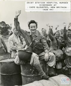 Lieutenant Rita G Hall and several Army nurses behind her wave farewell at Cape Gloucester, New Britain, August South Pacific Theater. US Army Signal Corps, Gift of Donald E. Mittelstaedt from The Digital Collections of the National WWII Museum, ~ Military Women, Military History, Women's Army Corps, Flight Nurse, Vintage Nurse, New Britain, Waves, Oral History, American Soldiers