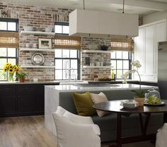 Stunning kitchen in brick and Carrera marble [Design: Design: Kevin Spearman Design Group]