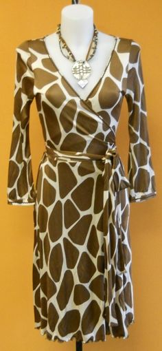 Stay stylish and feel comfortable in this Moschino animal print wrap dress! It's perfect for any occasion - whether it be work or dinner with your friends! Located at our N Ridge store- it is a size 8.