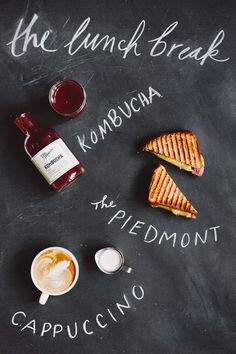 Goodies from the United By Blue Flagship Store: kombucha, the piedmont sandwich, and a fresh cappuccino. The Lunch Break.