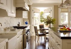 layout: table at the end of galley kitchen, just imagine the doors are a bay window.