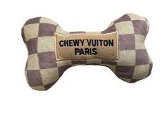 Do you love this label? Well let your dog share the thrill with this plush parody dog bone toy. Soft and durable with a speaker they'll love. In sizes small and large. They make great gifts too.