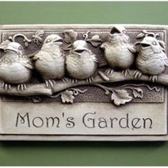 """Mom's Garden - Our classic Baby Birds plaque engraved with """"Mom's Garden"""" works well for so many occasions!   Image is Aged, other choices are Natural, Green, Terra Cotta and Designer White  Dimensions: 7.50 x 11.50 x 3.00 Composition: hand cast stone"""