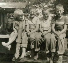 Country Kids...and Loving it...Me with my twin brothers and their friend, George between them on the back of Daddy's truck at our home in Argo. slj