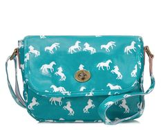 Ideal for everyday use, this crossbody style is crafted from durable laminated cotton printed in a charming horse pattern. Detailed with an adjustable shoulder strap, leather trim and a brass turnlock flap opening. The cotton-lined interior has plenty of room for your wallet, cell phone and compact whilst the front outer pocket is perfect for storing your keys and chapstick Wear yours cross-body to go hands-free.  Dimensions Cm: Length 25cm x Width 9cm x Height 20cm, Handle drop: 41 - 70cm…