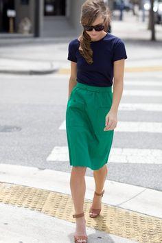 green skirt, navy top