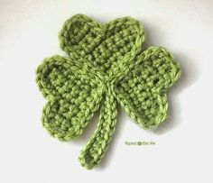 You can use my easy crochet heart pattern to make a shamrock! Sew three green hearts together and you have the leaves. A simple chain makes a stem | RepeatCrafterMe