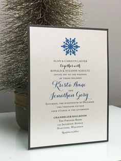 Elegant winter wedding invitation in blue and gray with snowflake detail by Paperwhites (paperwhites-invitations.com)
