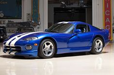 I will own a 96 blue with white racing stripes dodge viper one day!!!! 1996 Dodge Viper GTS Coupe