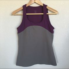 Purple + Gray Workout Tank NWOT NWOT Activewear tank from Zobha. Built-in non-padded bra, colors are a gorgeous purple and gray and fabric is so soft. Never worn. Ordered from Gilt and it was too small for me. Great for yoga, working out, etc! Fabric is Nylon/Spandex blend. Machine wash cold.  Look for the pre-made bundle to save on this and the other Zobha tank in my closet! Zobha Tops Tank Tops