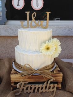 2 tier rustic wedding cake with rafia border by Frost It Cupcakery  rustic wedding cake