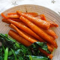 Honey Roasted Carrots:  71 5 All Star Reviews:   Time: 50 minutes  8 carrots, peeled   3 tablespoons olive oil   1/4 cup honey   salt and ground black pepper to taste