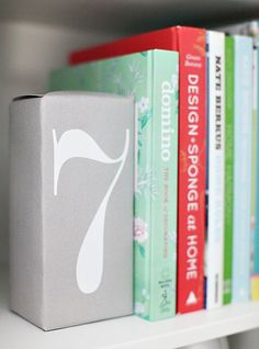This bookend is a brick! Wrap a brick with scrapbook paper or personalize it with an initial or number. 8 Creative And Easy DIY Bookends