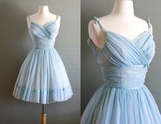 closure: Back Metal Zipper fabric: Silk Chiffon lined with Nylon and Stiff Netting at Skirt for volume  noted details: Gorgeous shade of blue chiffon that ruches at chest and waistband with a short flowy skirt.  circa 1950s   *pictured with crinoline slip. not included.