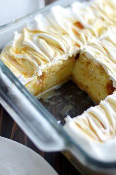Salted Caramel Cheesecake Poke Cake www.somethingswan...