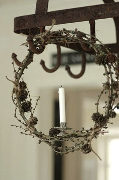I love this little silver candle clip on this homemade twiggy wreath.