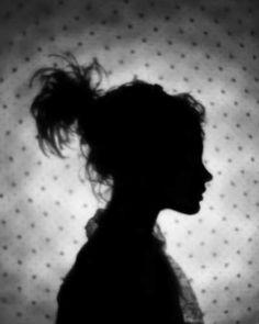 Sue Kae Grant, Niki. This silhouette portrait intrigues me through its beauty and simplicity. Although there is no detail of the girl in this profile, we can assume from the image that she is young, sweet, and maybe fragile. The pattern overlay with this silhouette successfully adds so much texture to this flat image.