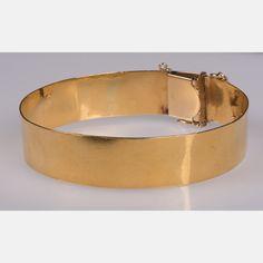 Lot 250 A 14KT. YELLOW GOLD CUFF BRACELET Est: $800 - $1,200 Description A 14kt. Yellow Gold Cuff Bracelet. Total weight: 24.4 dwt. Bracelet diameter: 2 3/4 in. Bracelet thickness: 5/8 in.