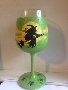 Here's a really cool wine glass that I painted today - a witch sailing along on her broom across the full moon and night clouds - there are spiders all along the bottom, too! - Asking $15 for this glass - all hand painted, one of a kind original glass - plus separate shipping.  Shipping in CONTINENTAL US only.  Please contact me if you are interested in purchasing this glass.  Thanks!