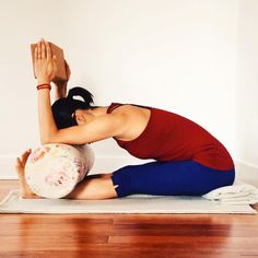 Paschimottanasana with a horizontal bolster.