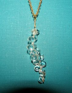 The Legend of Zelda: Twilight Princess Vessel Of Light Pendant Necklace.....i want to make earrings like this