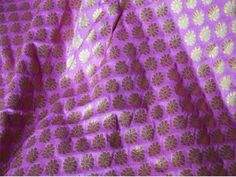 This is a beautiful pure benarse silk brocade floral design fabric in Mauve Pink and Gold. The fabric illustrate small golden woven Motifs on Mauve Pink background.  You can use this fabric to...