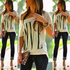 Trendy LOVE design T-Shirt featured in white. This casual top is super comfy and looks great. This top comes so that you can easily adjust the neck with a slight tug to suit how you would like it to h