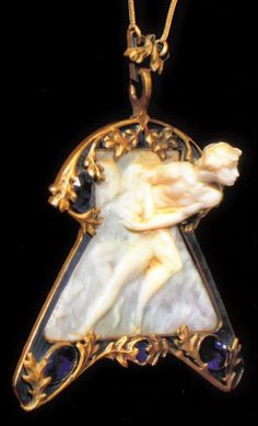 An Art Nouveau pendant - The Abduction - by René Lalique, 1900-02. Composed of gold, ivory, enamel and sapphires. Museu Calouste Gulbenkian, Lisbon. Source: René Lalique - Exceptional Jewellery 1890 - 1912. #Lalique #ArtNouveau #pendant