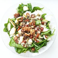 """""""Sweet spinach salad! Spinach, pear, dates, pumpkin seed and almonds on top, with a honey as dressing :)"""""""