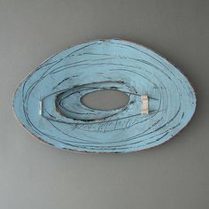 """Brooke marks-Swanson - back of a brooch - copper, fabricated and painted """"I am drawn to the beauty of things imperfect, impermanent and incomplete. Aerial photographs of hurricanes above water are stunning and seductive. The soft spiral and eye inform of terror and devastation. My object is to cause the viewer to speculate, imagine and to investigate, in a personal way, those issues relative to a sense of beauty, which drives the focus of my research."""" 495$"""