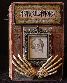 Make Easy Halloween Altered Book Art - old book - picture frame - skeleton hands - free printable graphics - glue