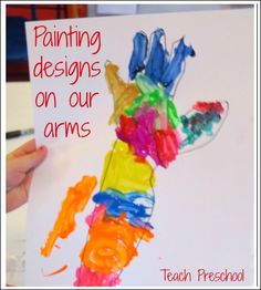 Painting designs on our arms by Teach Preschool