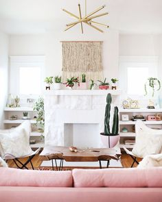 Plants and pink accents are our favorite things! Love this boho space // follow @shophesby for more inspiration