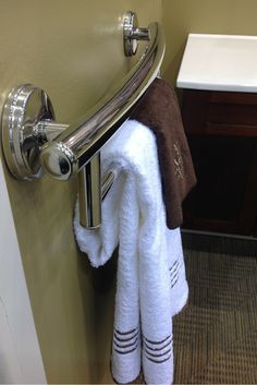 Decorative grab bar and towel bar - Universal and accessible design can be luxurious! This combination towel bar and grab bar is a great idea. http://innovatebuildingsolutions.com/products/bathrooms/roll-in-handicapped-shower