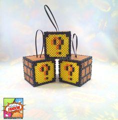 Super Mario Question Blocks - Set of 3 - Super Mario Party Favors, Video Game Wedding Favors, Super Mario Ornaments by MadamFANDOM on Etsy https://www.etsy.com/listing/246691574/super-mario-question-blocks-set-of-3