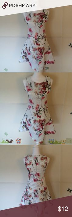 White Flora • Dress Gorgeous flora dress • fit like size 0-2 • never been worn • More color available in my closet. Dresses Mini