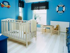 Envelop neutral furniture and floorboards in clean blue walls for dramatic effect -- #nurseries #decor #blue