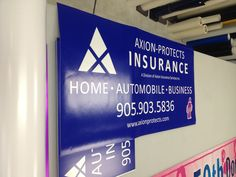 All ready for installation - window perf, signs and lawn signs. Complete branding package. Axion Protects Insurance - your home, auto and business needs.