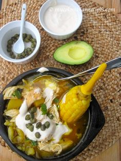 AJIACO BOGOTANO (COLOMBIAN CHICKEN AND POTATO SOUP) via mycolombianrecipes.com. I ate this in Bogota on Christmas Eve and it was amazing. I made this version for my family last Christmas Eve and it was delicious.
