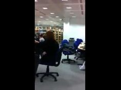 Girl trying to have fun in the library, playing the rowing chair. The result is embarassing, as expected.