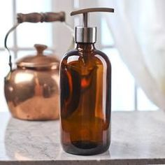 Add a touch of charm to your kitchen or bath with this simply understated, functional and reusable glass dispenser bottle.