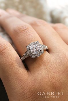 Vintage 14k White Gold Round Halo Engagement ring. Exquisitely crafted, this ring portrays a rich, elegant look. Your center stone is caressed by a luminous halo setting and glamorous setting while sitting atop a surprise diamond bridge.